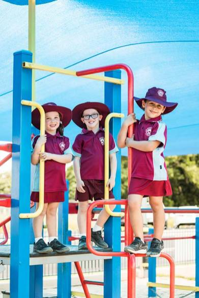 Portrait of young school students on the playground equipment