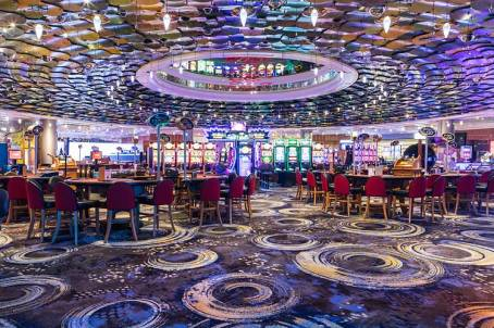 Interior of the Reef Hotel Casino showing the gaming floor and tables