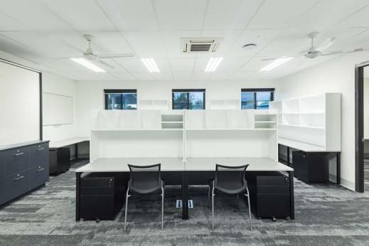 Interior of Trinity Bay High School multi purpose hall showing teacher's office space
