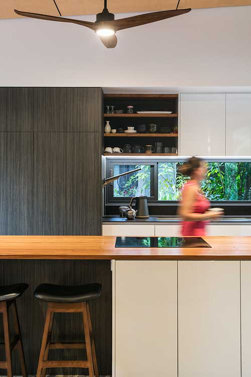 Kitchen interior with home owner walking through