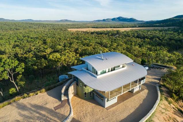Aerial view of the Walsh River House showing its hilltop location above savannah bushland