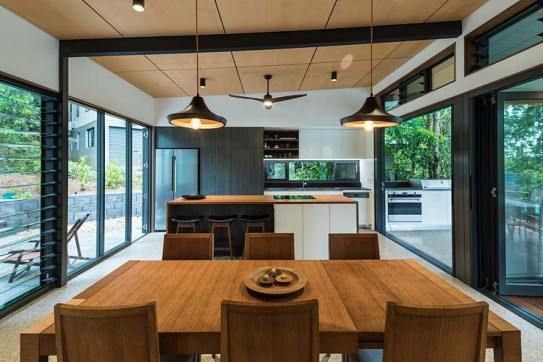 Residential home interior with view of dining and kitchen areas
