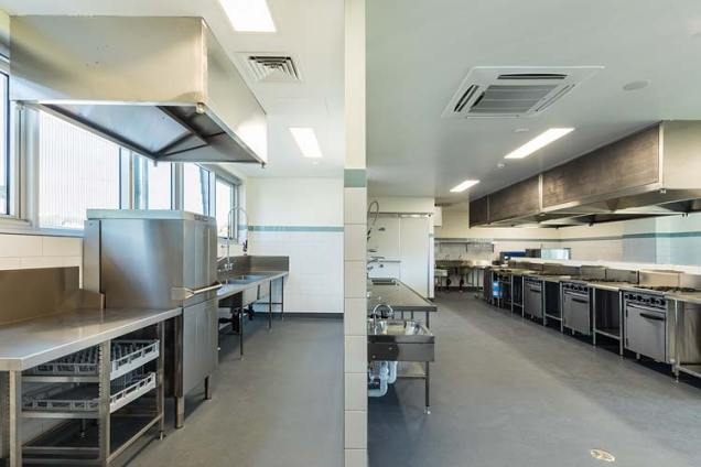 Interior of the St Monica's College building extension showing commercial kitchen