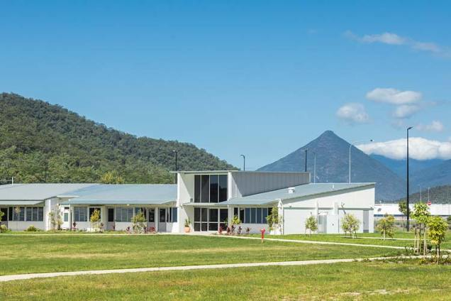 Exterior of school administration building with hills beyond