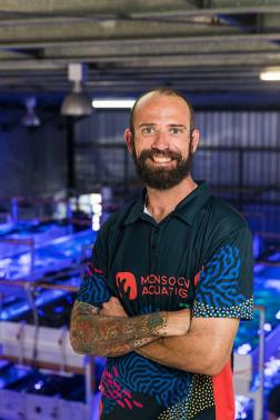 Portrait of a staff member at a hand-picked coral supply business