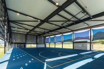 Interior of new school sports centre with covered basketball court