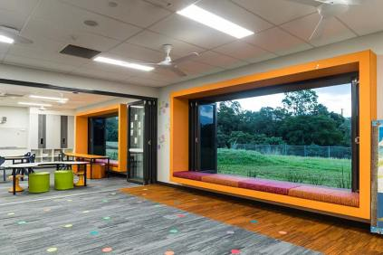 Interior of new school learning precinct with colourful window seating