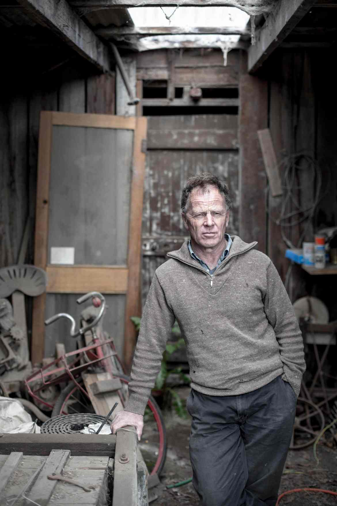 Portrait photography of a man in an old shed