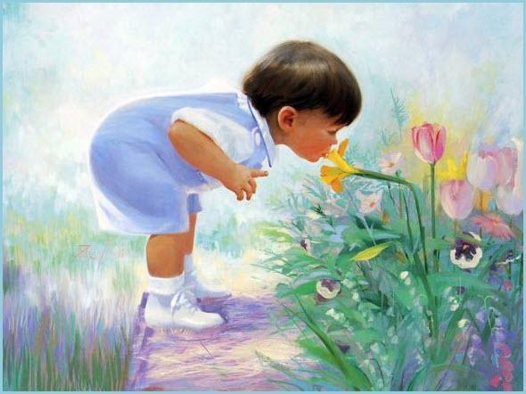 На картинке ребёнок нюхает цветок