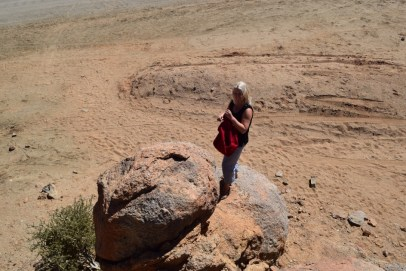 Triin on a dusty rock in Namibia