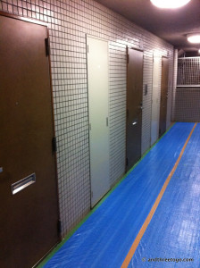 The hallway to the Umejima Red Ninja House, each brown door is an apartment. So close together!