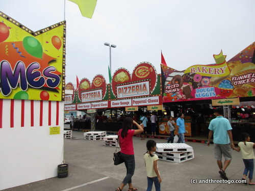 Unfortunately the funnel cakes and other carnival treats were just signs, I was so bummed! Under those signs were Thai snacks, Papaya salad, and clearance clothing.