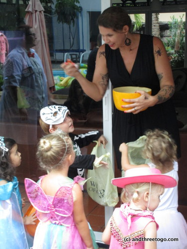 Me handing out candy at the party at Jo's. All the kids got to trick-or-treat at different doors in their houses.