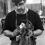 Rader working in sculpture studio.
