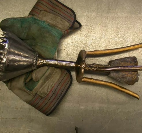 After the bronze was cast the investment material was removed and some sections were polished to see if there was any less obvious metal mixing. The gating has the golden color sometimes achieved with Al-Bronze alloys, but when polished, it was basically bronze colored underneath. The pour cup remained aluminum free, but will have to be placed in scrap bin because it has some contamination. There were three defined patinas on the bronze section. I originally thought they were due to concentrations of aluminum, but polishing did not reveal that to be true.