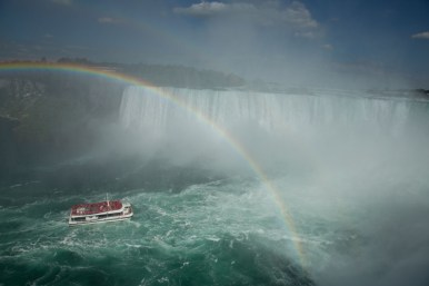 Tour boat approaching the Falls with a rainbow