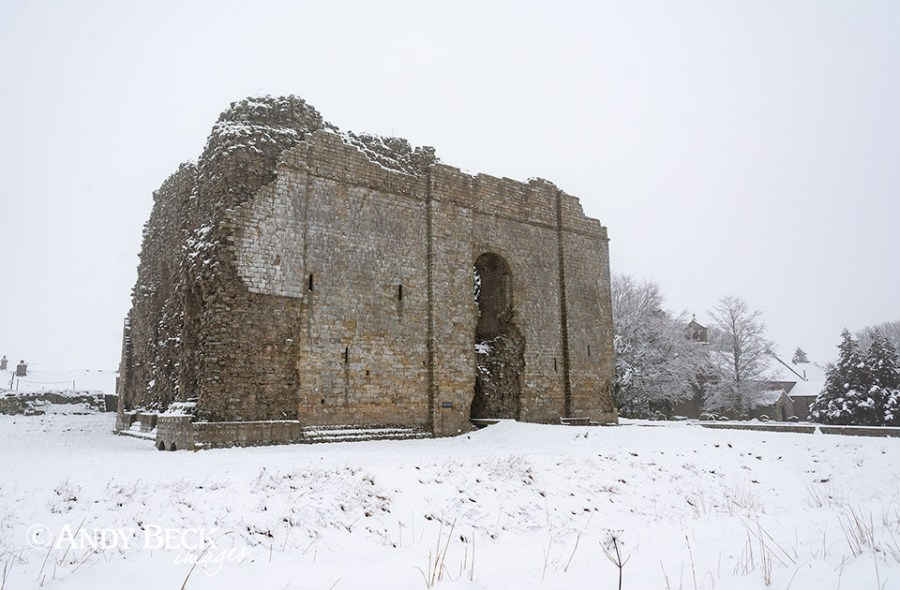 Bowes Castle and church in snow