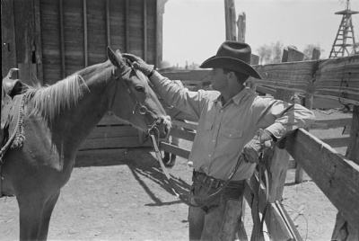 Cowboy Petting his Horse - Lee