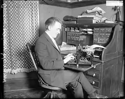 George Weinmann at the Typewriter