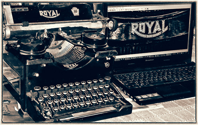 1927 Royal Typewriter and a modern laptop, side-by-side