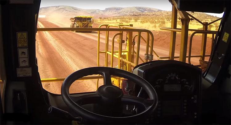 Caterpillar self-driving mining trucks in action