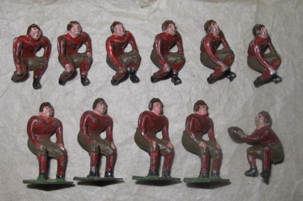Collectors lead toy figures of Harvard American football team. Made in Japan in the 1930s.
