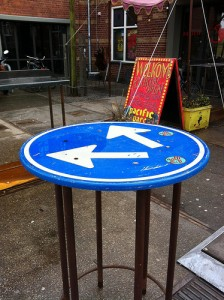 Old traffic sign used as a table in Amsterdam.