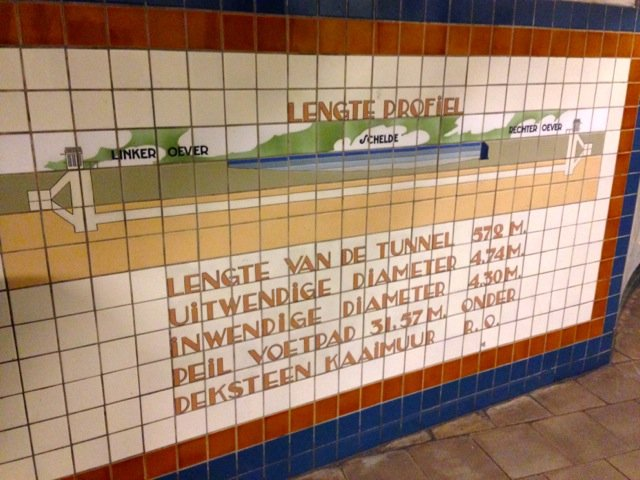Photo of tile diagram showing St Anna Pedestrian and Bike Tunnel under the Schelde River in Antwerp.
