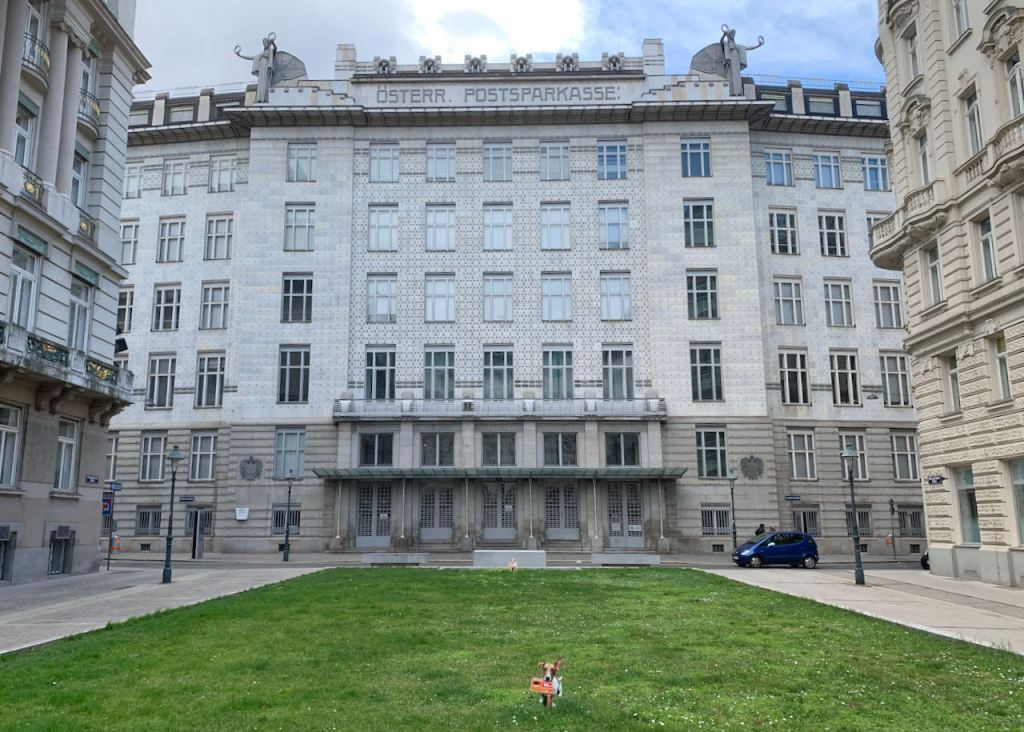 Photo of the front of the Postsparkasse building in Vienna