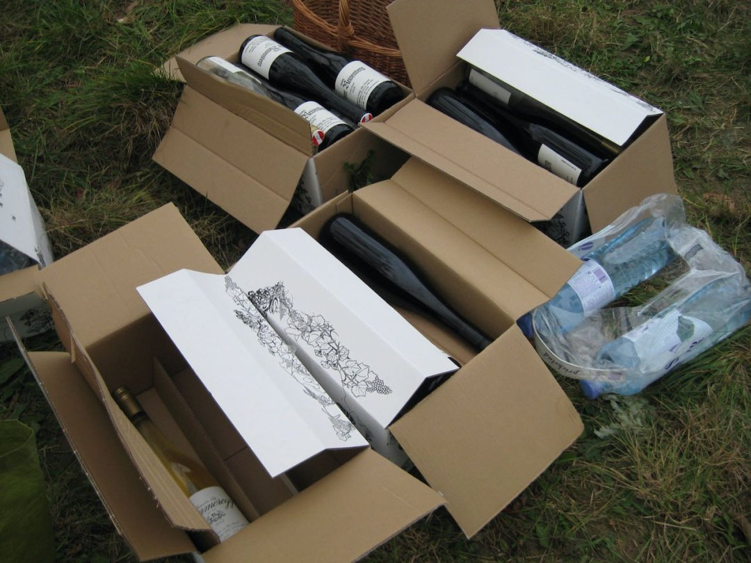 Photo of cardboard boxes with bottles of wine