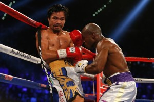 LAS VEGAS, NEVADA - APRIL 09: Timothy Bradley Jr. (R) punches Manny Pacquiao during their welterweight championship fight on April 9, 2016 at MGM Grand Garden Arena in Las Vegas, Nevada. Pacquiao won by unanimous decision. (Photo by Christian Petersen/Getty Images)