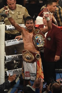 LAS VEGAS, NEVADA - APRIL 09: Manny Pacquiao celebrates as he leaves the ring after defeating Timothy Bradley Jr. in their welterweight championship fight on April 9, 2016 at MGM Grand Garden Arena in Las Vegas, Nevada. Pacquiao won by unanimous decision. (Photo by Ethan Miller/Getty Images)