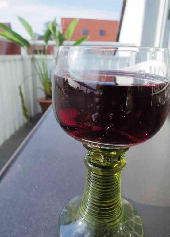 drinking red wine on my balcony