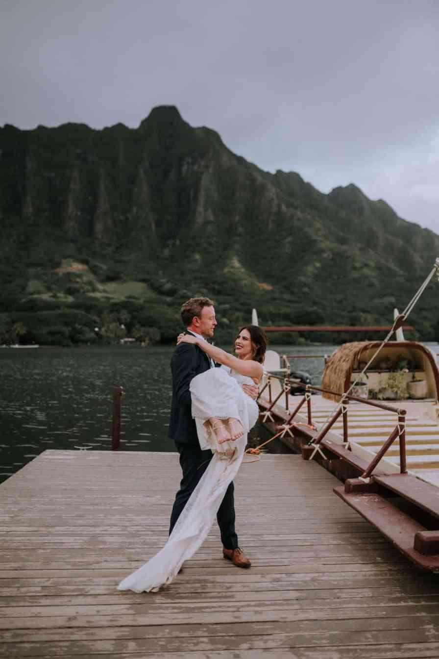 Bride and groom at Kualoa Ranch Secret Island oahu hawaii.