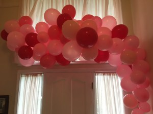 big pink balloon cascade over doorway for a party