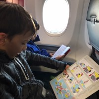 Trying out the SkyCouch on a flight from New Zealand with kids