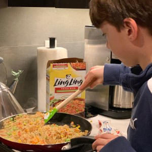 Cooking Ling Ling Chinese-style vegetable fried Rice with kids in the kitchen
