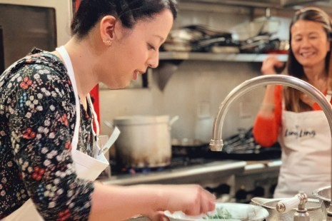 Terumi learning to cook with chef Katie Chin in Seattle with Ling Ling at Blue Ribbon