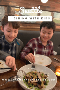 eating out in Seattle with kids at a cool Ballard neighborhood restaurant with travel-inspired cuisine and perfect beignets