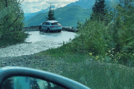 Driving a Porsche Cayenne through water on a Porsche Off Road Experience in Whistler with Canadian Wilderness Adventures