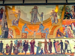 "When City Hall opened, ""The Nation at Work and Play"" (officially entitled ""Work, Administration, Celebration"") was advertised as the world's largest oil painting, measuring more than 42 x 74 feet. Muralist Henrik Sørenson actually painted it on a series of wooden panels. These in the center depict Charity, surrounded by Culture, Philosophy, and Family."