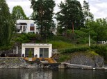 Check out the modern home and matching boat house.