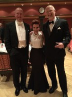 It's always amusing to sandwich the shortest person in the room between the tallest.