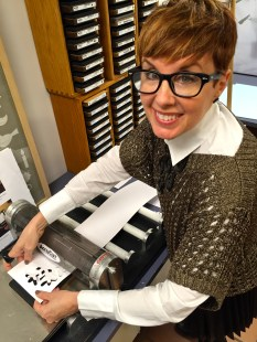 Stamping out the snowflake for this year's card. The cassettes behind me are the stamping plates for a variety of designs.