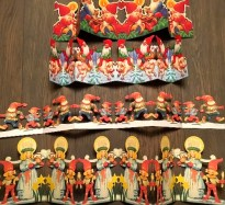 Paper decorations feature the red-capped Julenisse and Sancta Lucia.