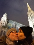 A quick kiss for luck beneath St. Stephen's shadow.