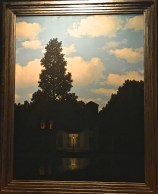 """One of his """"Empire of Lights"""" paintings, which hint at the almost ominous air of quiet suburbia."""