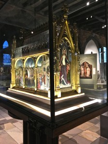 The St. Ursula's Shrine (c. 1489) is Hans Memling's triumph. It's considered a masterpiece of Flemish Primitives painting. Meant to hold the remains of St. Ursula, it mimics a Gothic church, with the paintings acting as stained glass.