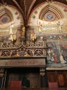 """The fabulous fireplace touts the 13th-century proclamation that """"All the artisans, laborers, and citizens of Bruges are free."""" Pretty emancipated thinking for the time."""
