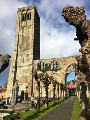 Behind Damme's Church of Our Lady are the evocative remnants of its bell tower.
